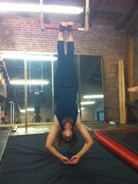 Doing sit ups from toe hangs is part of every aerial workout. Notice: not every workout, just aerial!